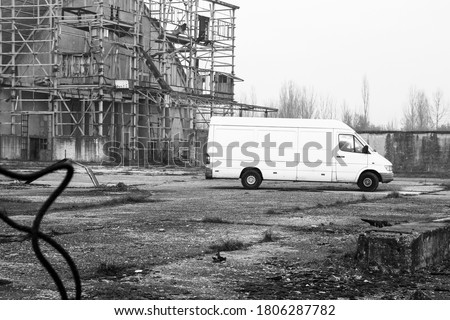 Suspicious white van moving in abandoned factory - Men going to destroyed factory with van for secretly or illegal fact - Illegal activities, stolen and hidden merchandise in abandoned and Lost place