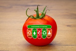 Sustainability Rating label on tomato with high, med and low ratings for food carbon footprint, water use, land use, packaging waste and chemical waste label. Consumer environmental rating label.