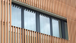 Sustainable architecture, facade cladding with wooden slats