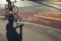 Sustainable city transportation: Bikers commuting to the work, riding fast in a cycling line on the street (motion blurred image)