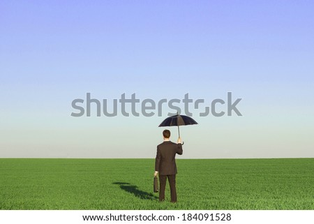sustainable development insurance concept, businessman holding umbrella in the fields