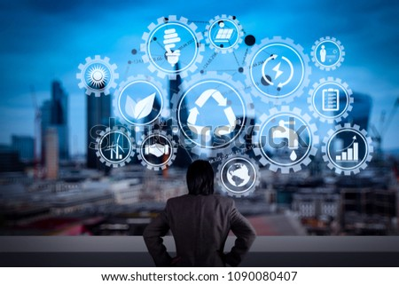 Sustainable development with icons of renewable energy and natural resources preservation with environment protection inside connected gears.businessman stands successfully on building. #1090080407