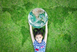 Sustainable environment, world ecosystem, CSR with people, ESG ecological friendly and go green concept with happy girl kid raising earth globe on lawn planet map. Element of image furnished by NASA