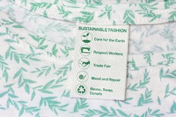 sustainable fashion label with care for the earth, respect for workers, trade fair, mend and repair, reuse, swap or donate with icons.