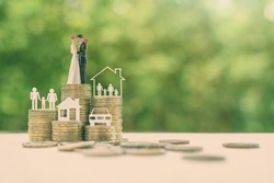 Sustainable financial goal for family life or married life concept : Miniature wedding couple, parent & child, a house or home, a car on rows of rising coins, depicts savings or growth for new family