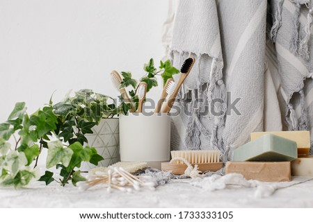 sustainable lifestyle concept. eco natural bamboo toothbrush, crystal deodorant, luffa, natural soap, cotton ear sticks, towel. bathroom essentials, plastic free items