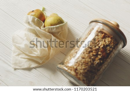 sustainable lifestyle concept. zero waste. eco natural bags with fruits and granola in glass. eco friendly, plastic free items. reuse, reduce, recycle, refuse. bulk store