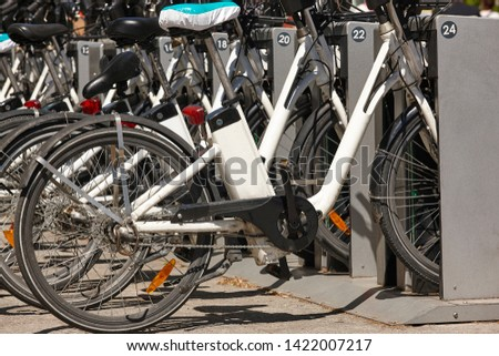 Sustainable urban mobility. Bikes on the city. Electric transport. Traffic #1422007217