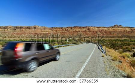 SUV car entering monument valley, utah