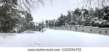 Suwon, Gyeonggi-do/South Korea-Feb 19 2109: Hwaseong Portress in snow #1322096705