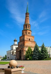 Suyumbike Tower in Kazan Kremlin, Tatarstan, Russia. This leaning building is famous tourist attraction of Kazan. Vertical view of old landmark on blue sky background in Kazan city center in summer.