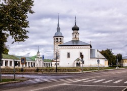 Suzdal landscape in the autumn day, Russia. View of shopping arcades, the bell tower of the Kazan Church,Resurrection Church to bargain from Lenin street.