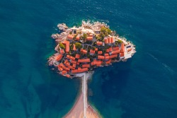 Sveti Stefan, Montenegro. Aerial above view of the Sveti Stefan island. Drone footage. Famous travel destination.