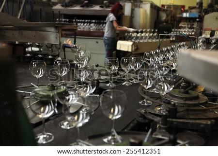 SVETLA NAD SAZAVOU, CZECH REPUBLIC - NOVEMBER 7, 2014: Automatic production of machine blown stemware at the Bohemian glass factory Crystalite Bohemia in Svetla nad Sazavou, Czech Republic.