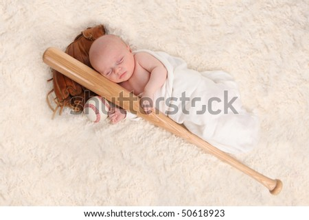 Swaddled Sleeping Baby Boy With a Baseball Bat and Ball