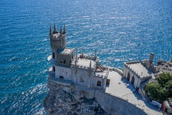 Swallow's Nest castle on the edge of a steep cliff on the seashore. Shooting from the air.