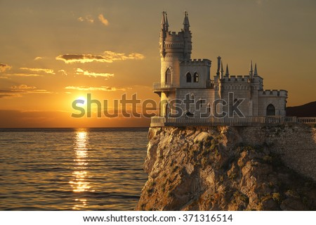 Swallow\'s Nest castle on the rock over the Black Sea on the sunset. Gaspra. Crimea, Russia
