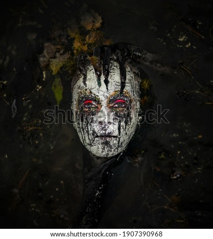 Swamp monster. A fabulous creature in a dark swamp. Scary creature at night.