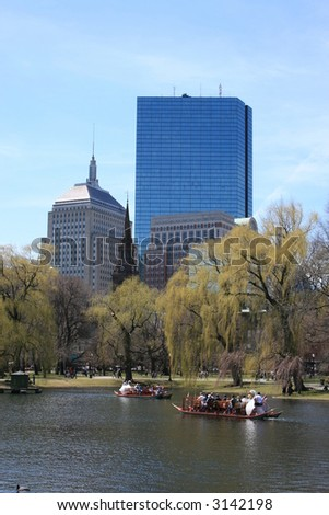 Swan Boats in Boston's Public Gardens.  John Hancock tower in the background.
