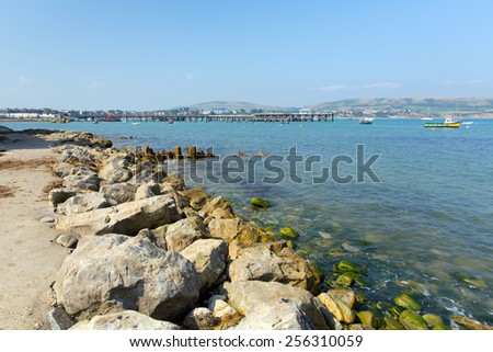 Swanage harbour and jetty Dorset England UK with blue sea and sky on a beautiful summer day on the English Jurassic coast