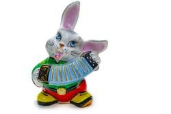 Swap meet. glazed earthenware figurine of a cheerful bunny with an accordion