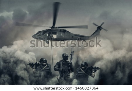 Swat forces and helicopter between smoke