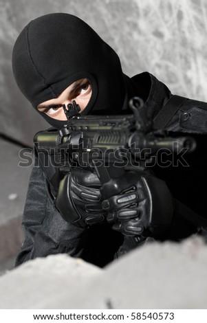 SWAT member targeting with automatic american M-4 gun - stock photo