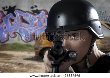 SWAT police officer aiming a shotgun