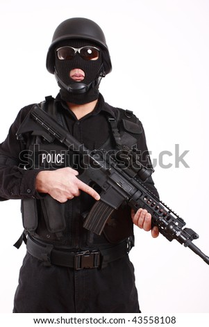 SWAT police officer with assault gun.