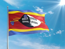 Swaziland national flag waving in the wind against deep blue sky. High quality fabric. International relations concept.