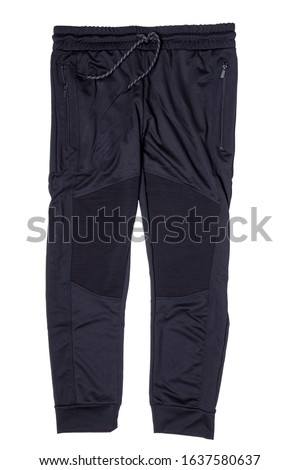 Sweat pants isolated. Closeup of mens fashionable black sweat pants or jersey trousers isolated on a white background. Outfit for workout. Stock photo ©