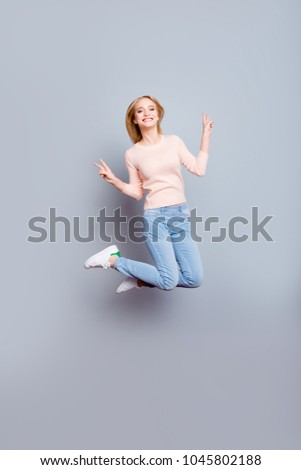 Sweater denim freedom freelancer win winner fun joy enjoy luck fortune come true weekend concept. Full-length vertical of cheerful careless joyful cute manager jumping up isolated on gray background #1045802188