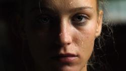 Sweaty Woman Looking at the Camera, Close-up