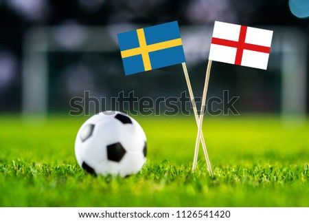 Sweden and England national Flag on football green grass. #1126541420