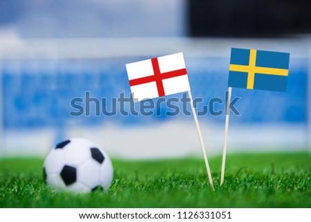 Sweden and England national Flag on football green grass. Sweden - England, Quarterfinal, 7. July, Football match. #1126331051