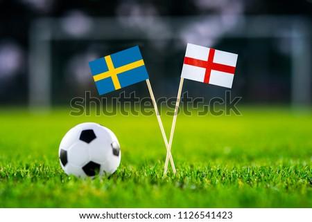 Sweden and England national Flag on football green grass. Sweden - England, Quarterfinal, 7. July, Football match. #1126541423