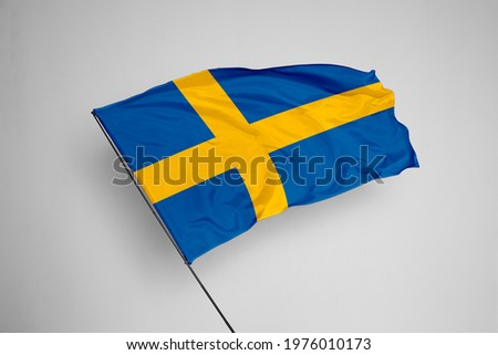 Sweden flag isolated on white background with clipping path. close up waving flag of Sweden. flag symbols of Sweden. Sweden flag frame with empty space for your text. Сток-фото ©