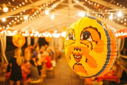 Swedes love to use brightly colored lanterns for decorations during their crayfish parties, which typically take place in the end of August. The main lantern is usually of a smiling yellow moon.