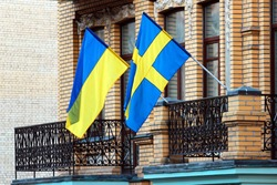 Swedish and Ukrainian flags on a balcony in Kiev, Ukraine.