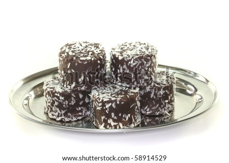 Swedish balls stacked on a tray before a white background