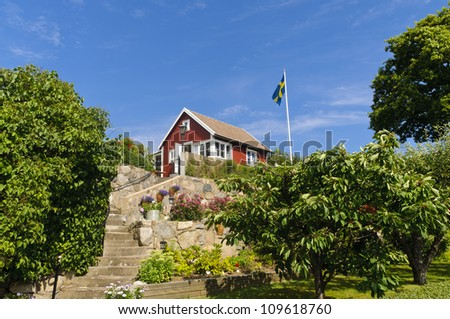 "Swedish cottages painted in the typical ""Falun red"" color in Brandaholm, Karlskrona county, Sweden - stock photo"