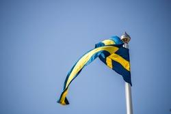 Swedish flag and blue skies.