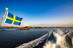 swedish flag in the wind on the ferry baltic sea