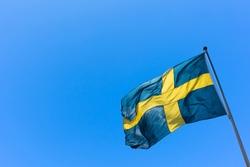 Swedish Flag on blue sky. Swedish Flag Day concept.  Sveriges nationaldag. National Day of Sweden.