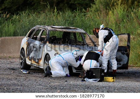Swedish forensic scientists investigate the burned-out car that is believed to be connected to a shooting in which a 12-year-old girl died. Stock photo ©