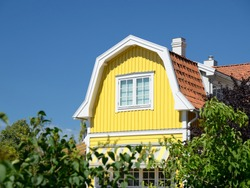 Swedish housing in summer with blue sky.