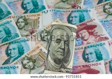 swedish krona, the currency of sweden. american dollar bills.