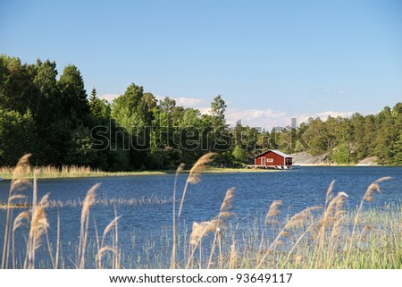 swedish landscape with little red house on an island (finnhamn) near Stockholm