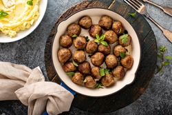 Swedish meatballs cooked in a cast iron pan