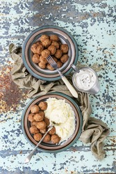 Swedish meatballs Kottbullar served with mashed potatoes, cream sauce and decorated with thyme. Top View. Copy Space